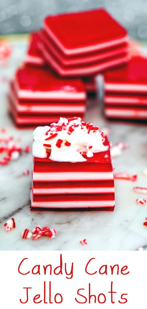 Candy Cane Jello Shots -- Looking for a deliciously boozy holiday party treat? These Candy Cane Jello Shots are red and white layered jello squares made with vodka and peppermint schnapps! | wearenotmartha.com #jelloshots #candycanes #holidaydrinks #partycocktails #jello