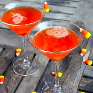 Candy Corn Martini -- Candy corn infused vodka and butterscotch schnapps combine to make a perfectly sweet Candy Corn Martini, best served once a year on Halloween | wearenotmartha.com