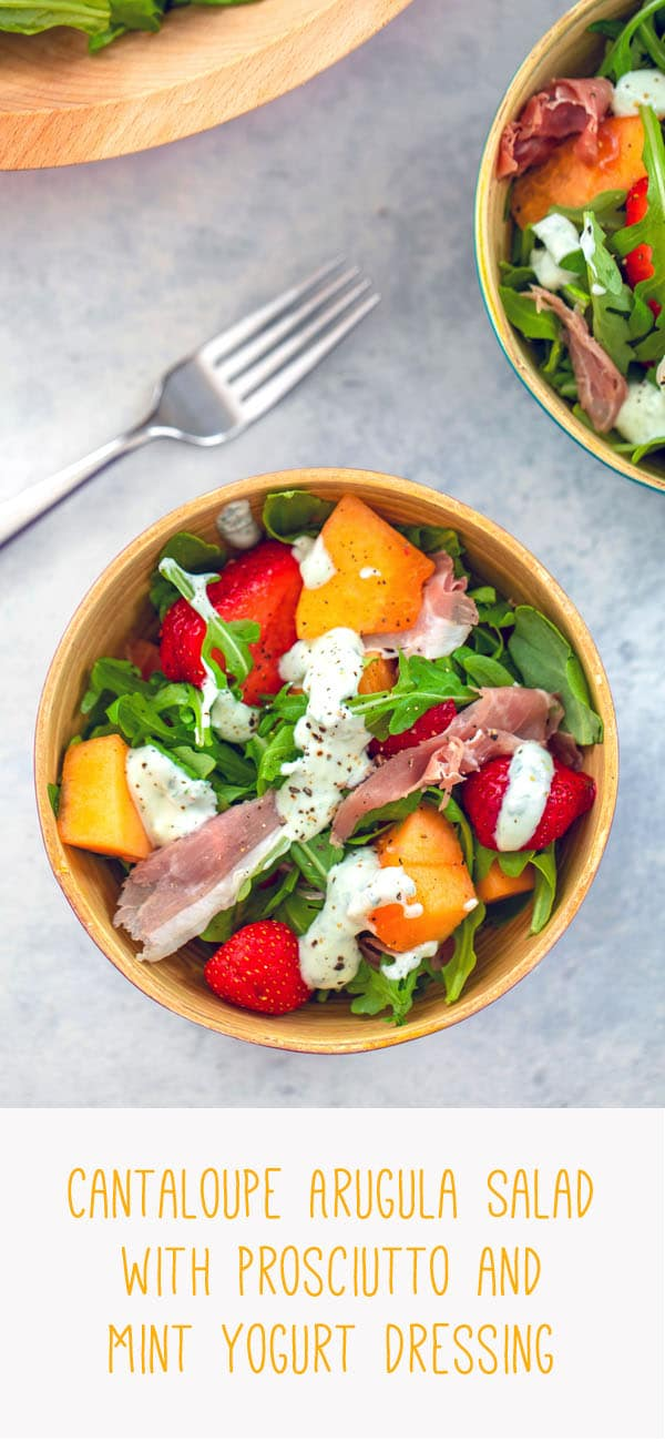 Cantaloupe and Prosciutto Arugula Salad with Mint Yogurt Dressing -- This easy to prepare Cantaloupe and Prosciutto Salad is packed with fresh ingredients, including strawberries, arugula, and goat cheese and is topped with a delicious mint yogurt dressing | wearenotmartha.com #salad #cantaloupe #prosciutto