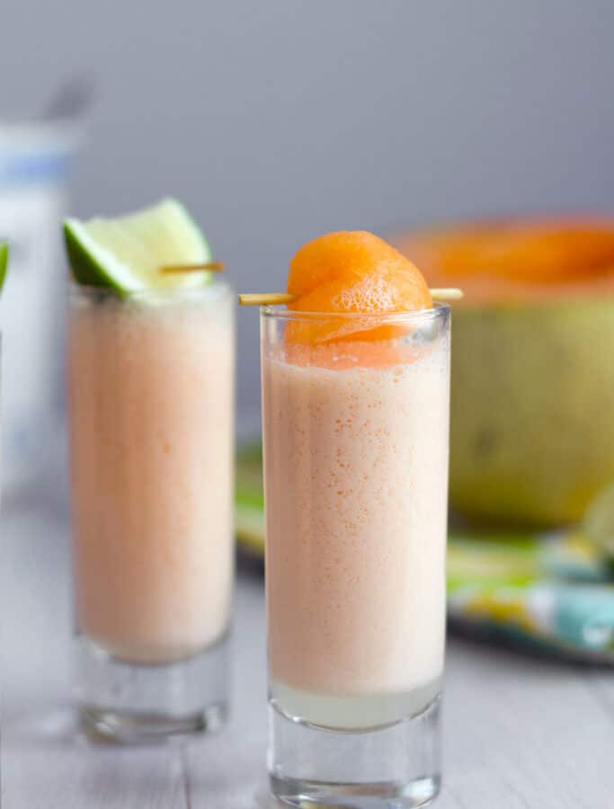 Cantaloupe Boozy Smoothie Shooters -- These cantaloupe boozy smoothie shooters are the perfect party sippers. Made with a few simple ingredients you don't often find together, they have just a little vodka kick | wearenotmartha.com