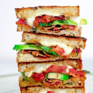 Caprese Grilled Cheese with Avocado and Bacon -- Take the caprese sandwich to whole new levels with this Caprese Grilled Cheese Sandwich with roasted tomatoes, basil, mozzarella, avocado and bacon | wearenotmartha.com