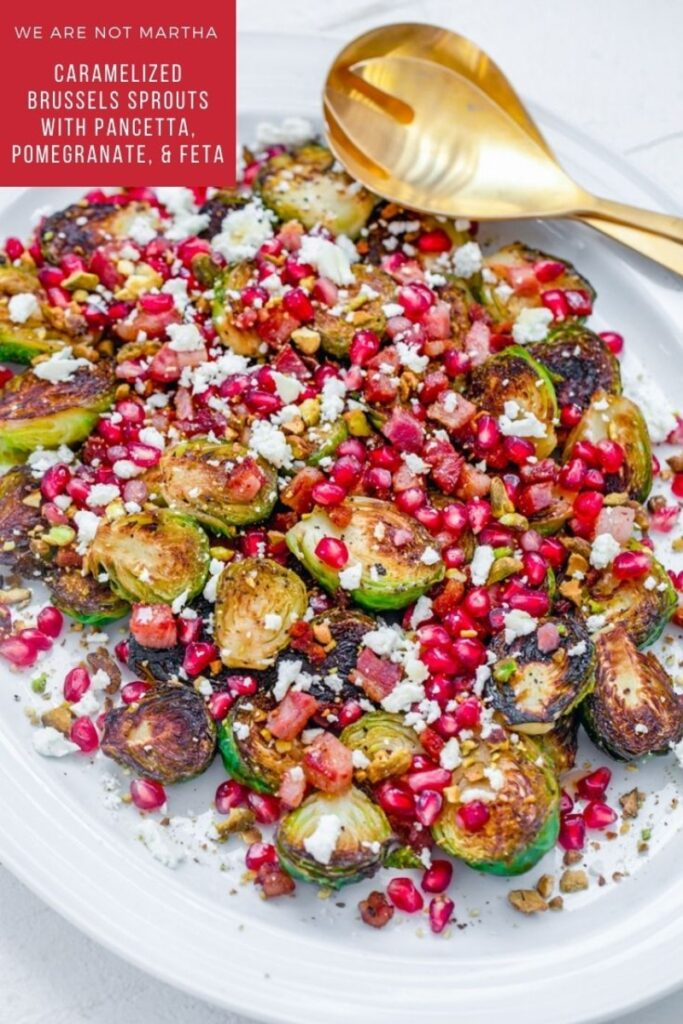 These Caramelized Brussels Sprouts are combined with pancetta, pomegranate, and feta and make for the best fall and winter side dish, perfect for Thanksgiving and Christmas! | wearenotmartha.com