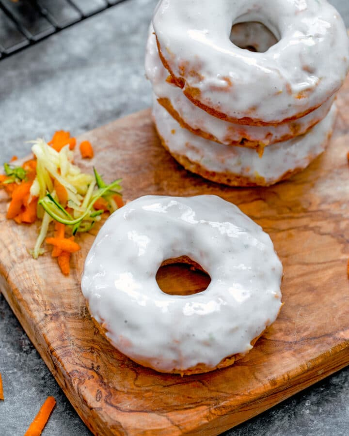 Carrot Zucchini Donuts -- Zucchini bread is great, but zucchini donuts are way more fun! These Carrot Zucchini Donuts combine two delicious vegetables into one sweet donut, glazed with vanilla Greek yogurt icing and perfect for breakfast or dessert | wearenotmartha.com #donuts #zucchinirecipes #zucchinidonuts #bakedgoods #summerdesserts