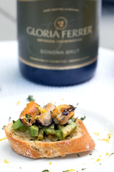 Sparkling Wine Mussel Crostini with Avocado, Grilled Lemon, and Basil -- The perfect party appetizer #GloriousBites | wearenotmartha.com