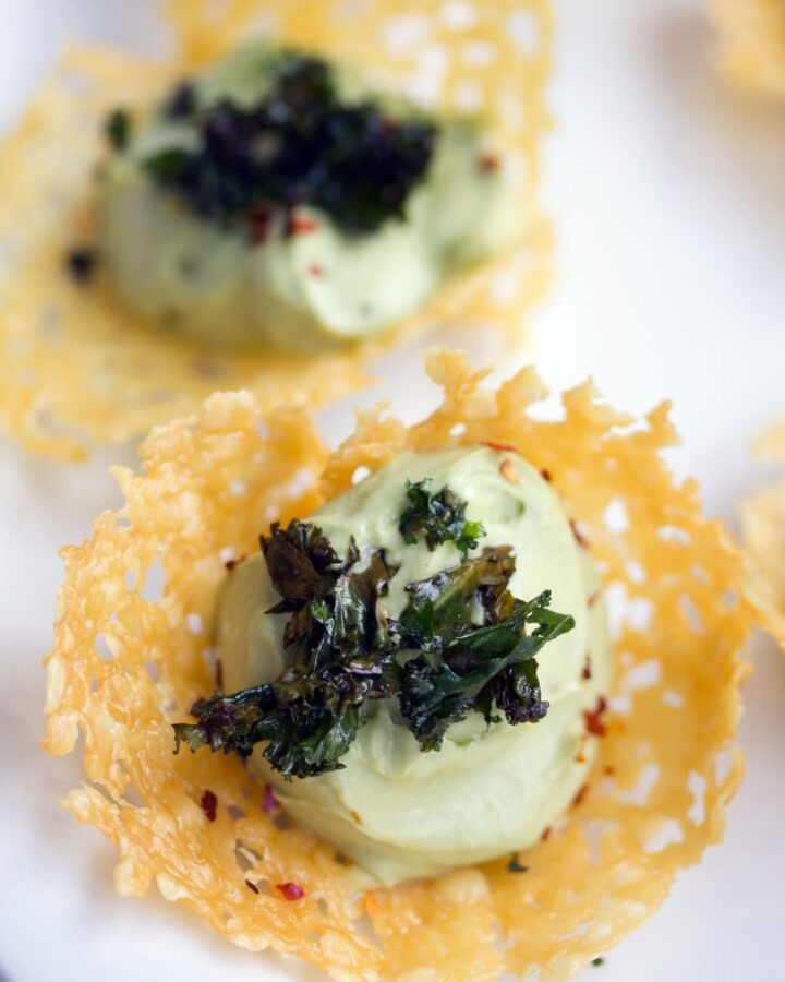 Cheddar Cups with Avocado Feta Mousse -- These Cheddar Cups with Avocado Feta Mousse are the best ever party appetizer. The cheese cups require one ingredient and the whole appetizer is so easy to put together | wearenotmartha.com