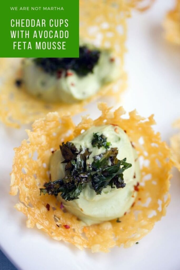Cheddar Cups with Avocado Feta Mousse make for the perfect bite-sized party appetizer. They're impressive and easy to make! | wearenotmartha.com #appetizers #partyappetizers #cheesecups #avocado