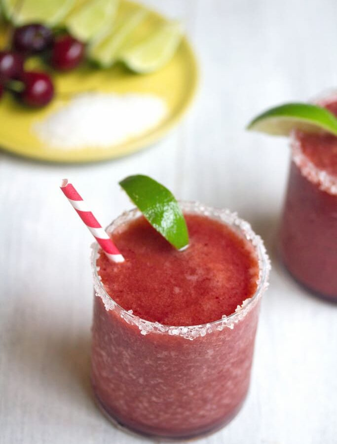 Cherry Lime Margarita -- This Cherry Margarita mixes fresh cherries and lime for a very summery combo... Just add tequila and blend to enjoy a refreshing frosty summer drink! | wearenotmartha.com