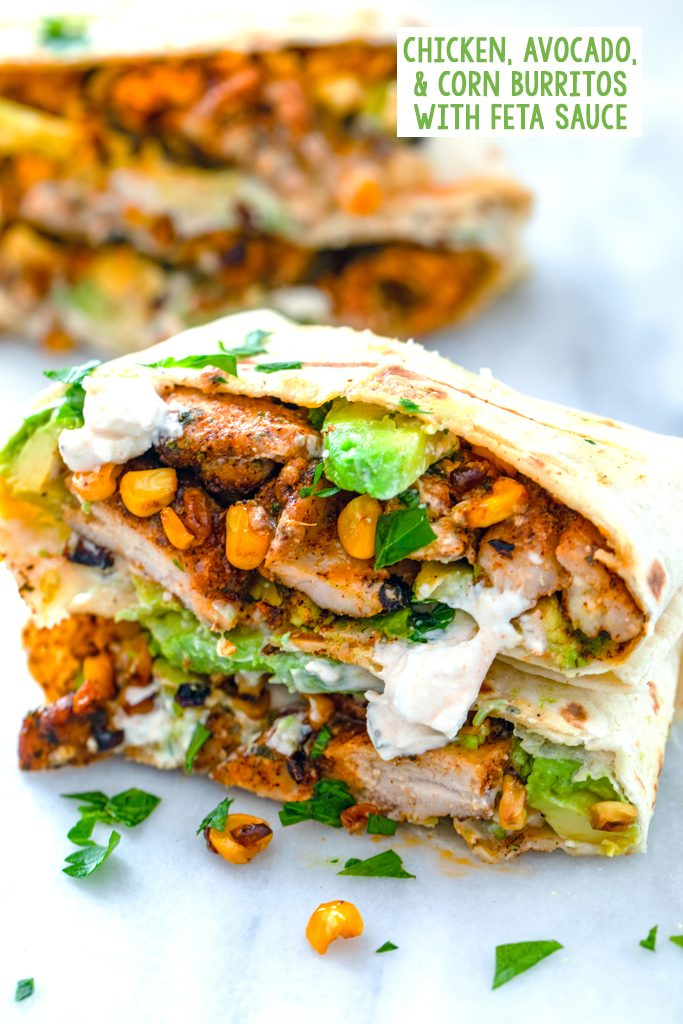Chicken, avocado, and corn burritos cut in half and stacked on each other to showcase ingredients with feta sauce drizzled on them and recipe title at top