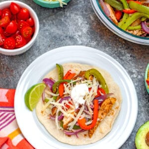 Chicken Fajitas -- You may think fajitas are just a fancy Mexican restaurant meal (that sizzle!). But this recipe for Chicken Fajitas is an incredibly easy dinner anyone can make. Substitute chicken with steak or shrimp if you desire | wearenotmartha.com #chickenfajitas #fajitas #mexicanfood #easydinners #quickdinners