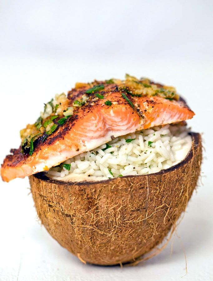 Chili Lime Salmon Over Coconut Rice -- This Chili Lime Salmon Over Coconut Rice is a super simple weeknight dinner that's easy, healthy, and delicious. Serve it in a coconut half if you want to impress, but it's just as tasty on a plate!| wearenotmartha.com