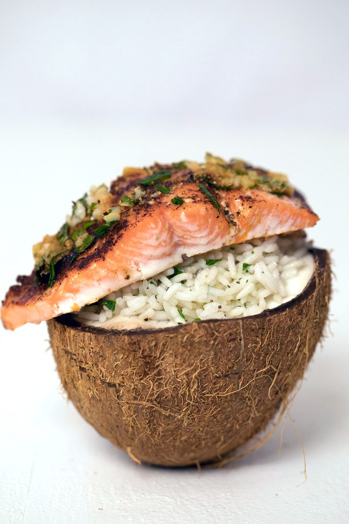 Chili Lime Salmon Over Coconut Rice -- This easy weeknight dinner is served in a fresh coconut! | wearenotmartha.com