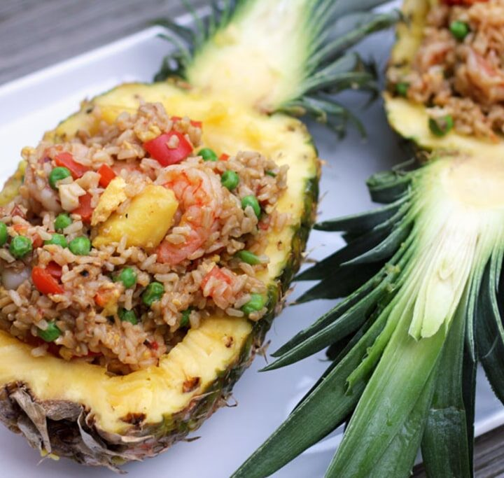 Chili Mango Shrimp Pineapple Fried Rice -- A little bit spicy and a little bit sweet, this Chili Mango Shrimp Pineapple Fried Rice is packed full of flavor and served in a pineapple for some extra tropical fun | wearenotmartha.com