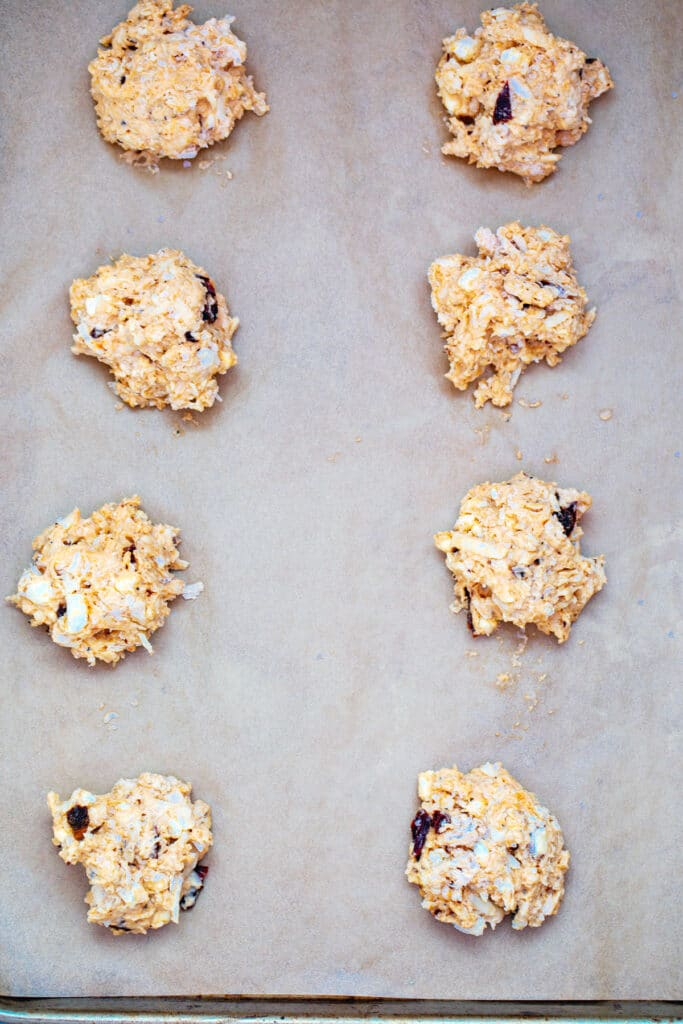 Biscuit dough scooped onto baking sheet