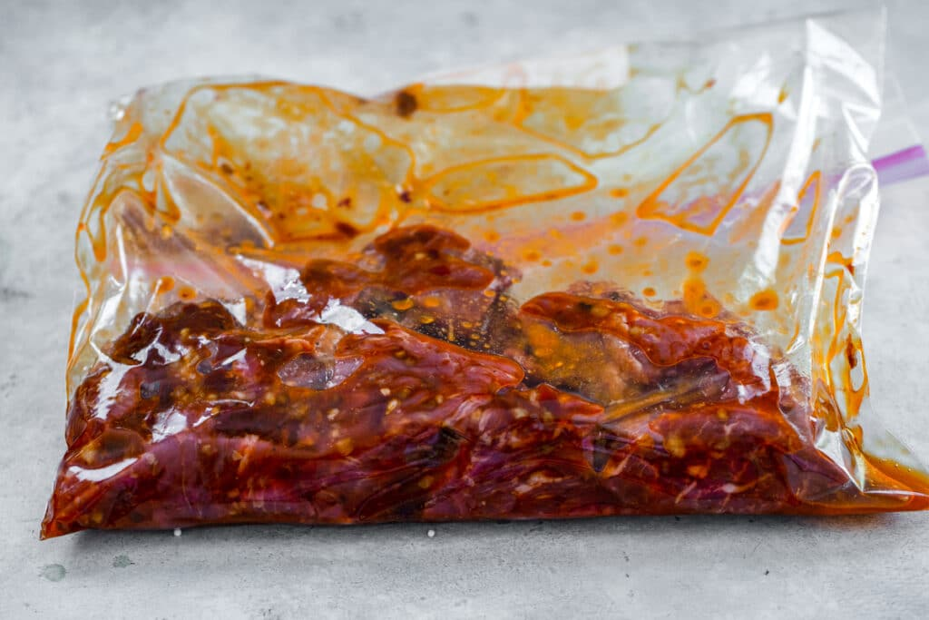 Sirloin marinating in bag with chipotle marinade