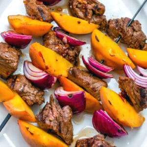 With a simple (but incredibly flavorful!) marinade and just 10 minutes on the grill, these Chipotle Steak and Peach Kabobs will become your new favorite summer meal! They're perfect for a low-key dinner at home or for outdoor entertaining with friends.