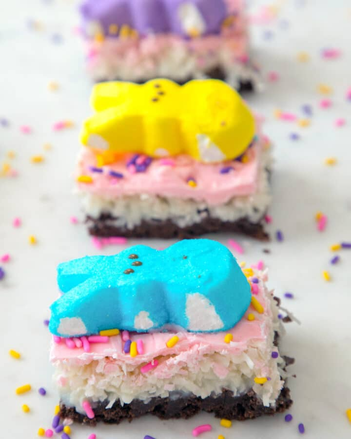 Chocolate Brownie Coconut Peeps Bars -- This layered bar has a chocolate brownie base, a layer of sweet coconut, a white chocolate topping, and plenty of Peeps and sprinkles. Whether you're making them for Easter or just a spring celebration, these Peeps bars are sure to delight! | wearenotmartha.com