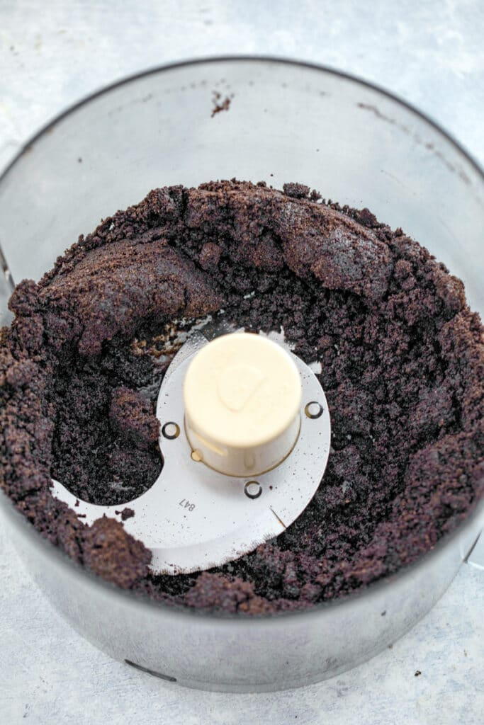 Overhead view of Oreo cookie crumbs in food processor