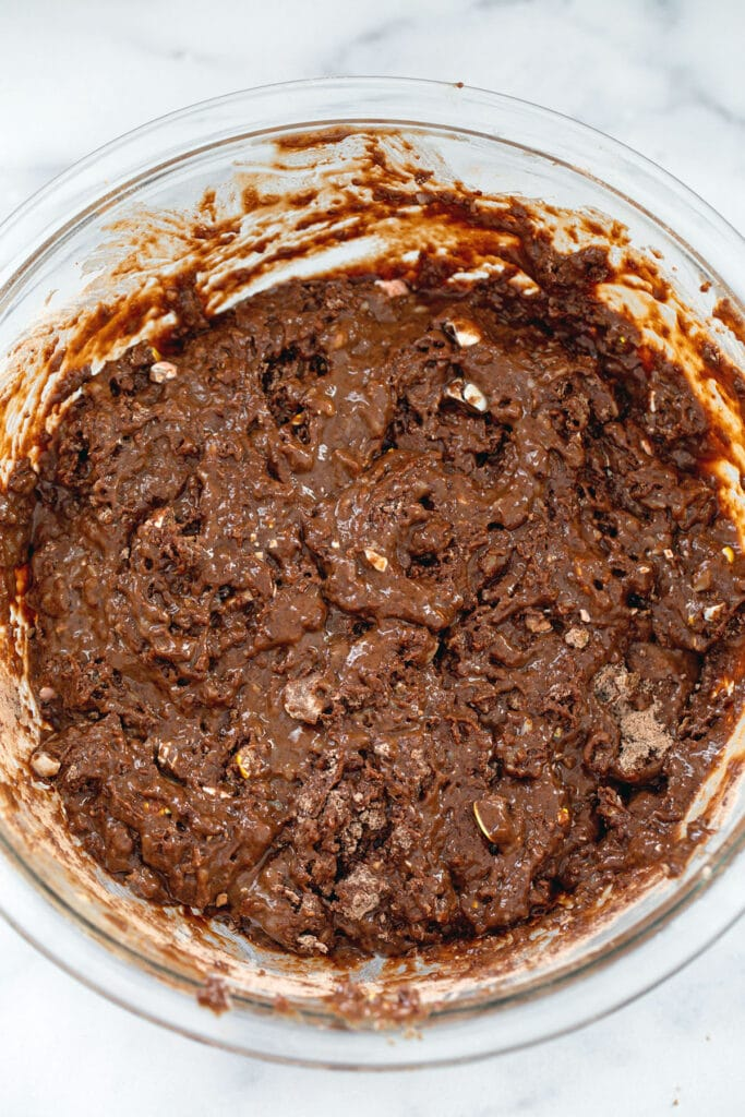 Chocolate donut batter mixed together in bowl