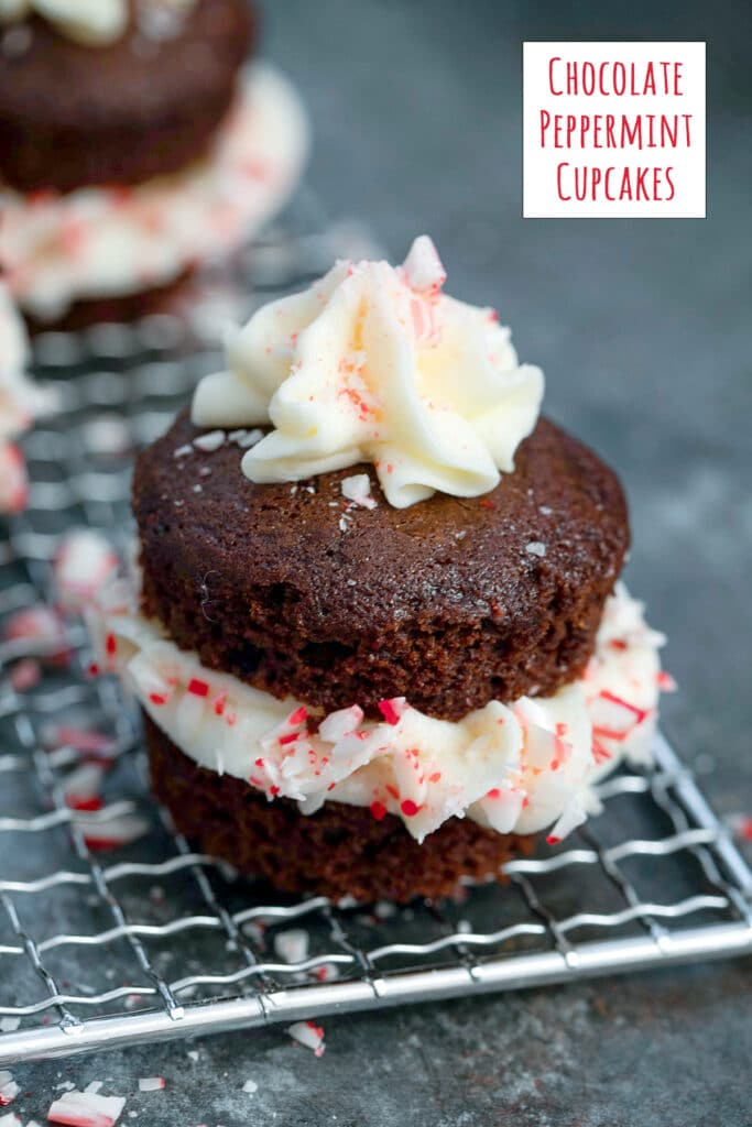 Chocolate peppermint cupcake on a baking rack with frosting in middle and on top and crushed candy canes with recipe title at top