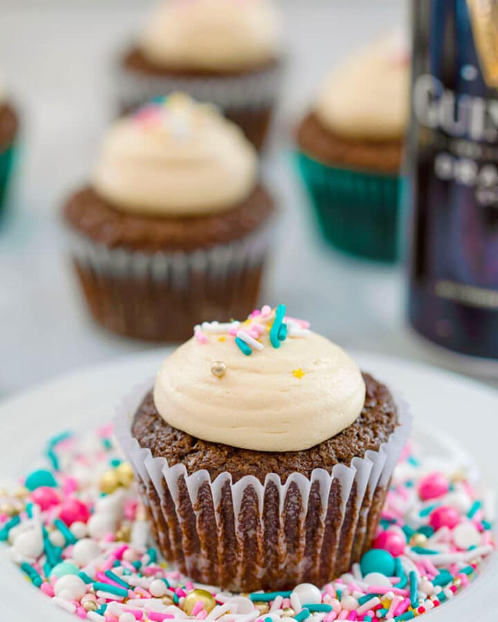 Chocolate Stout Cupcakes with Irish Whiskey Filling and Baileys Frosting -- You don't have to be Irish and it doesn't have to be St. Patrick's Day for you to fall in love with these Chocolate Stout Cupcakes with Irish Whiskey Filling and Baileys Frosting! | wearenotmartha.com