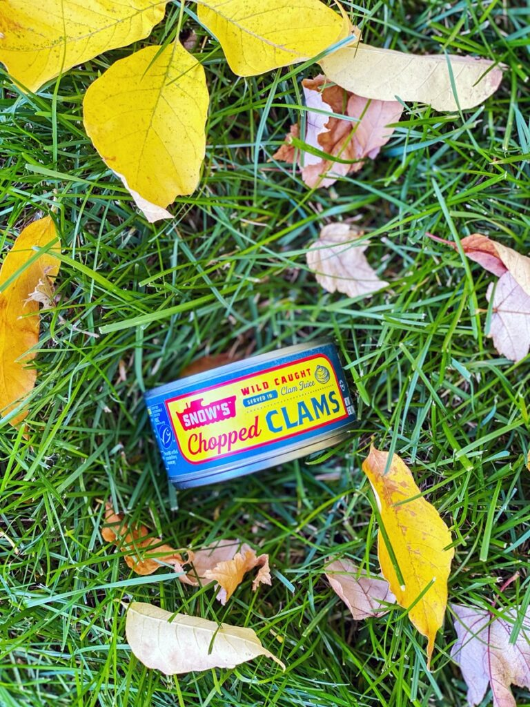 Can of chopped clams in the grass