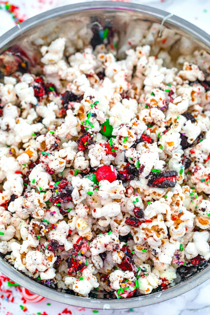 Overhead view of Christmas popcorn mix in bowl