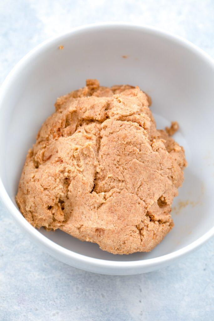 Cinnamon roll dough in small bowl