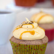 Cinnamon Cupcakes with Pumpkin Coffee Cream Cheese Frosting -- These cinnamon cupcakes are filled and topped with a pumpkin coffee cream cheese frosting that will have you licking the bowl clean! | wearenotmartha.com