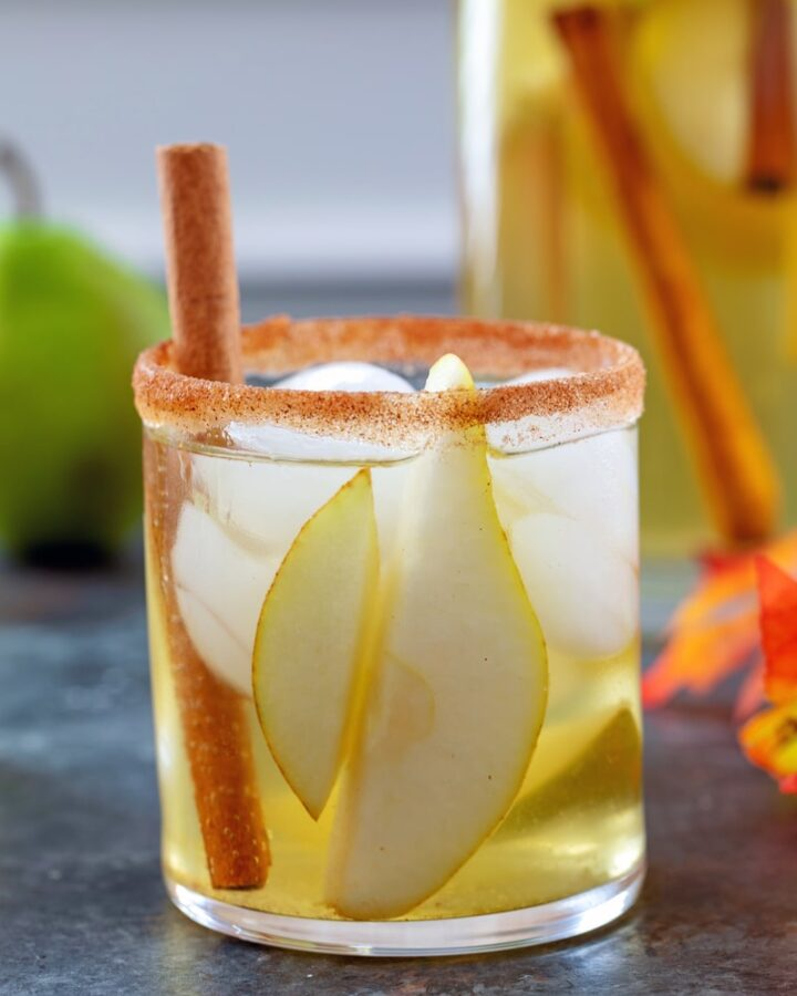 Cinnamon Pear Sangria -- Packed with crisp white wine, vodka, fresh pears and a cinnamon pear simple syrup, this Cinnamon Pear Sangria is like fall in a glass! | wearenotmartha.com #sangria #pearcocktails #fallcocktails #pearrecipes #whitewine #sangriarecipes