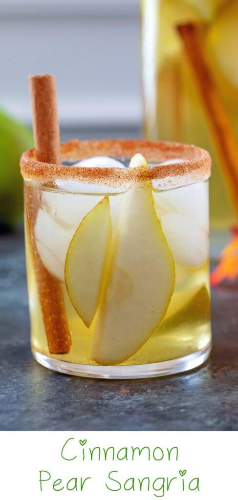Cinnamon Pear Sangria -- Packed with crisp white wine, vodka, fresh pears and a cinnamon pear simple syrup, this Cinnamon Pear Sangria is like fall in a glass! | wearenotmartha.com #sangria #pearcocktails #fallcocktails #pearrecipes #whitewine #sangriarecipes