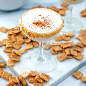 Overhead view of a Cinnamon Toast Crunch cocktail with cereal all around