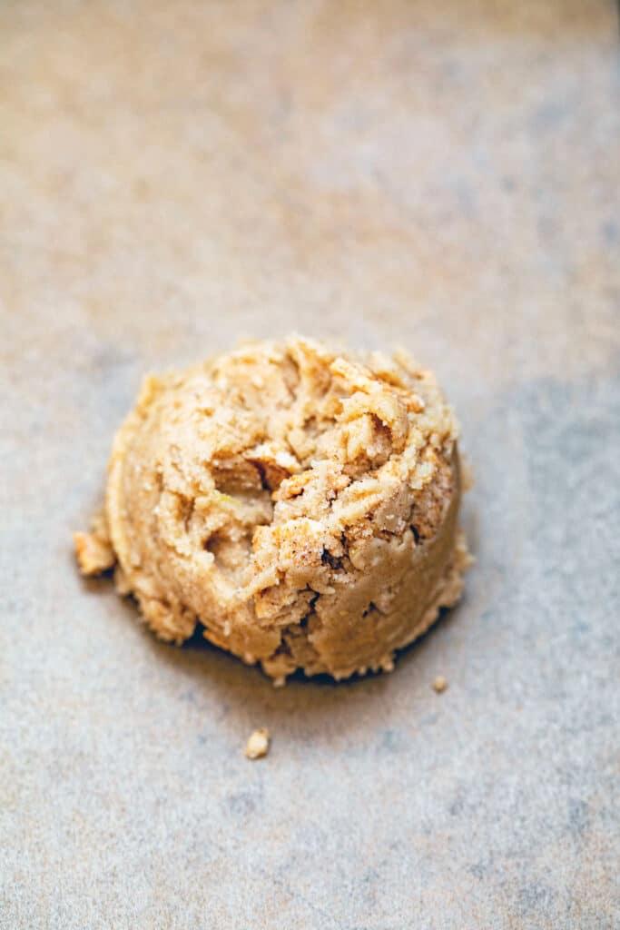 Cinnamon Toast Crunch cookie batter scooped on baking sheet