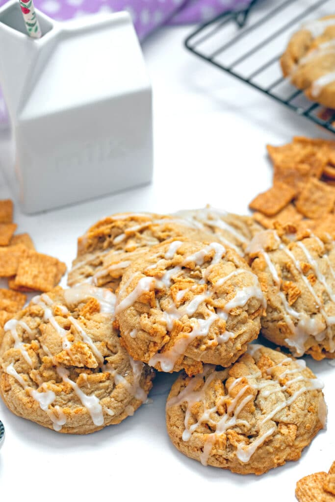 Overhead view of multiple Cinnamon Toast Crunch cookies with ceramic milk carton in background