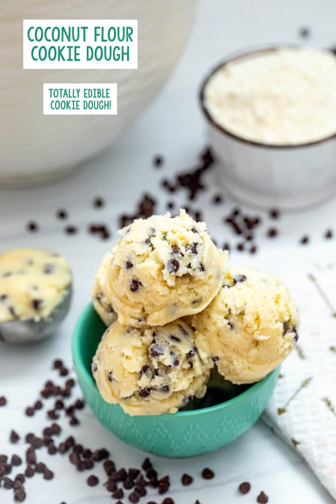 Overhead view of a bowl of coconut flour cookie dough balls with chocolate chips, flour, and a scoop of cookie dough in background with recipe title at top