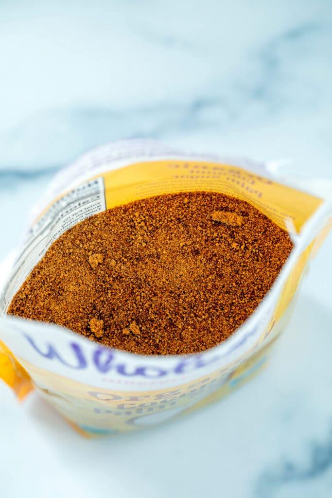 Overhead view of brown coconut sugar in bag