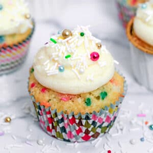 When you have a reason to celebrate, these Confetti Cupcakes with Champagne Custard are the perfect celebratory treat! The cake is packed with sprinkles, filled with a delicious champagne custard, and topped with a vanilla champagne buttercream.