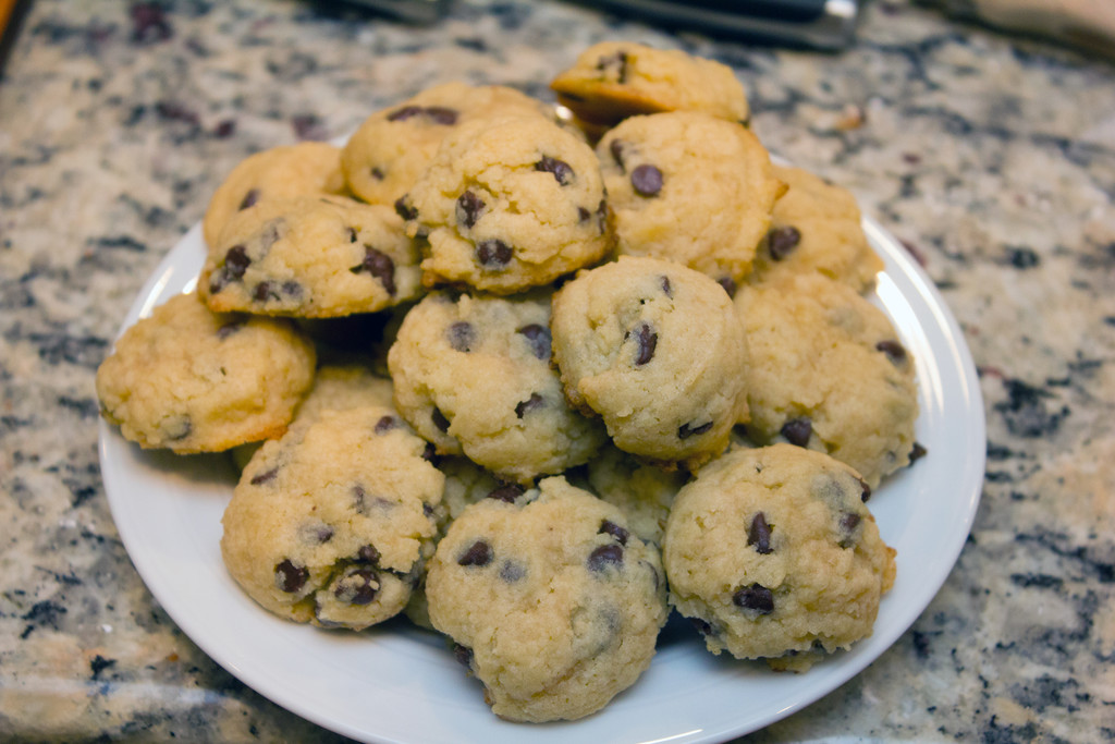 Overhead view of mini chocolate chip cookies piled on a plate