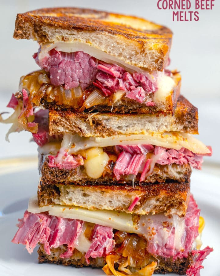 Head-on view of corned beef melt sandwich halves stacked on top of each other