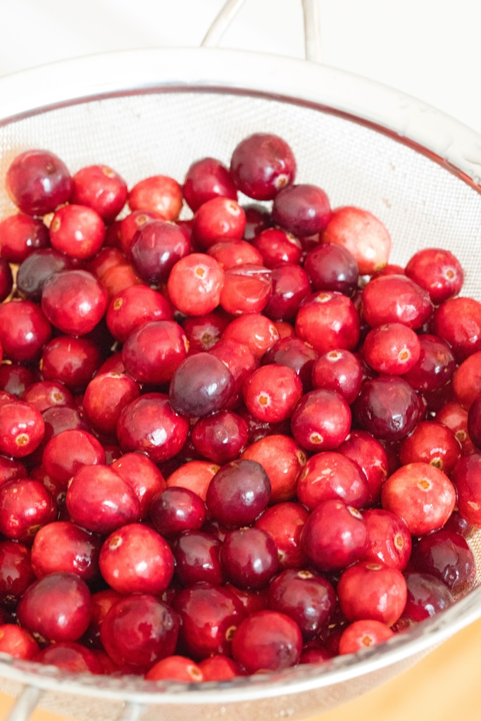 Overhead view of fresh cranberries in a strainer