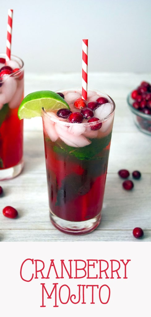 Cranberry Mojitos -- If you think mojitos are a summer-only cocktail, let these Cranberry Mojitos change your mind! This perfect holiday cocktail is made with homemade cranberry simple syrup, lime, rum, and plenty of mint | wearenotmartha.com