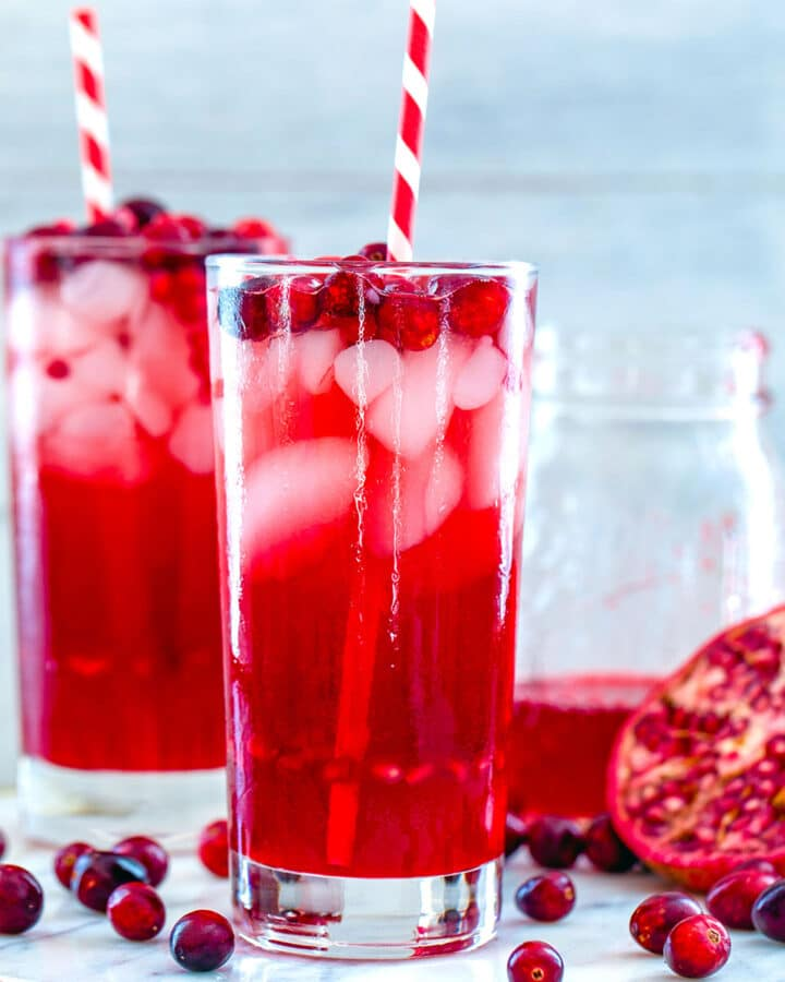 Cranberry Pomegranate Cocktail -- This Cranberry Pomegranate Sparkler is the holiday cocktail of your dreams. Made with cranberry simple syrup and pomegranate juice, it's perfectly sweet and festive. It's also delicious as a virgin cocktail   wearenotmartha.com