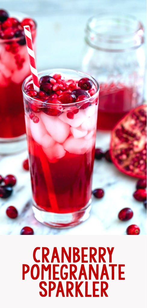 Cranberry Pomegranate Cocktail -- This Cranberry Pomegranate Sparkler is the holiday cocktail of your dreams. Made with cranberry simple syrup and pomegranate juice, it's perfectly sweet and festive. It's also delicious as a virgin cocktail | wearenotmartha.com #cranberry #pomegranate #cocktail #vodka #holidays #christmas