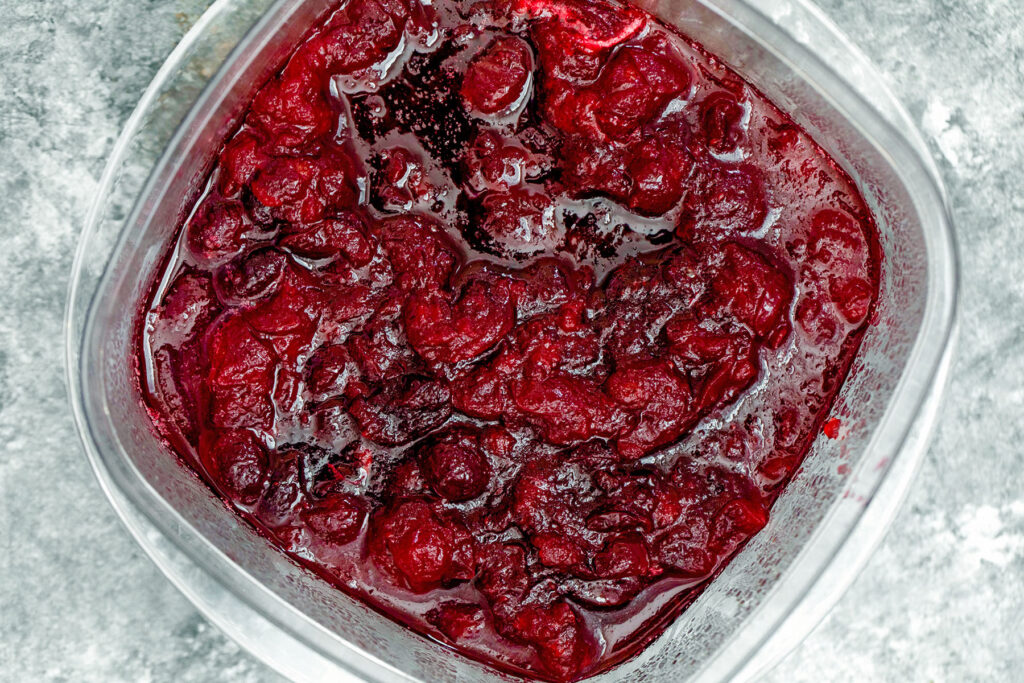 Homemade cranberry sauce in container