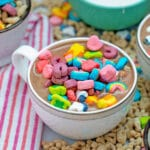 Head-on view of Lucky Charms hot chocolate topped with cereal marshmallows with cereal all around