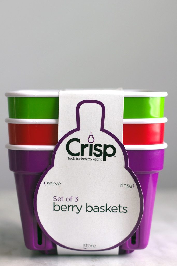 A stack of three Crisp brand berry baskets