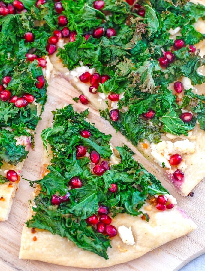 Crispy Kale, Habanero, and Pomegranate Flatbread -- This crispy kale flatbread is topped with spicy habanero peppers, pomegranate arils, feta cheese, and honey for an incredibly unique and totally mind-blowing flavor combination | wearenotmartha.com
