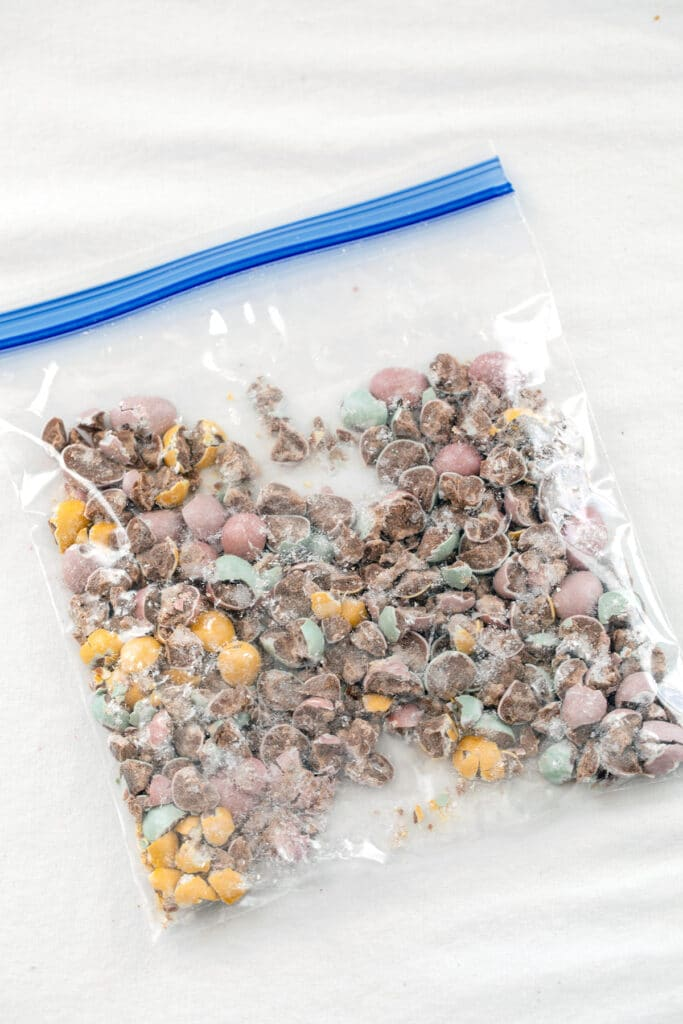 Overhead view of Cadbury Mini Eggs crushed in a bag