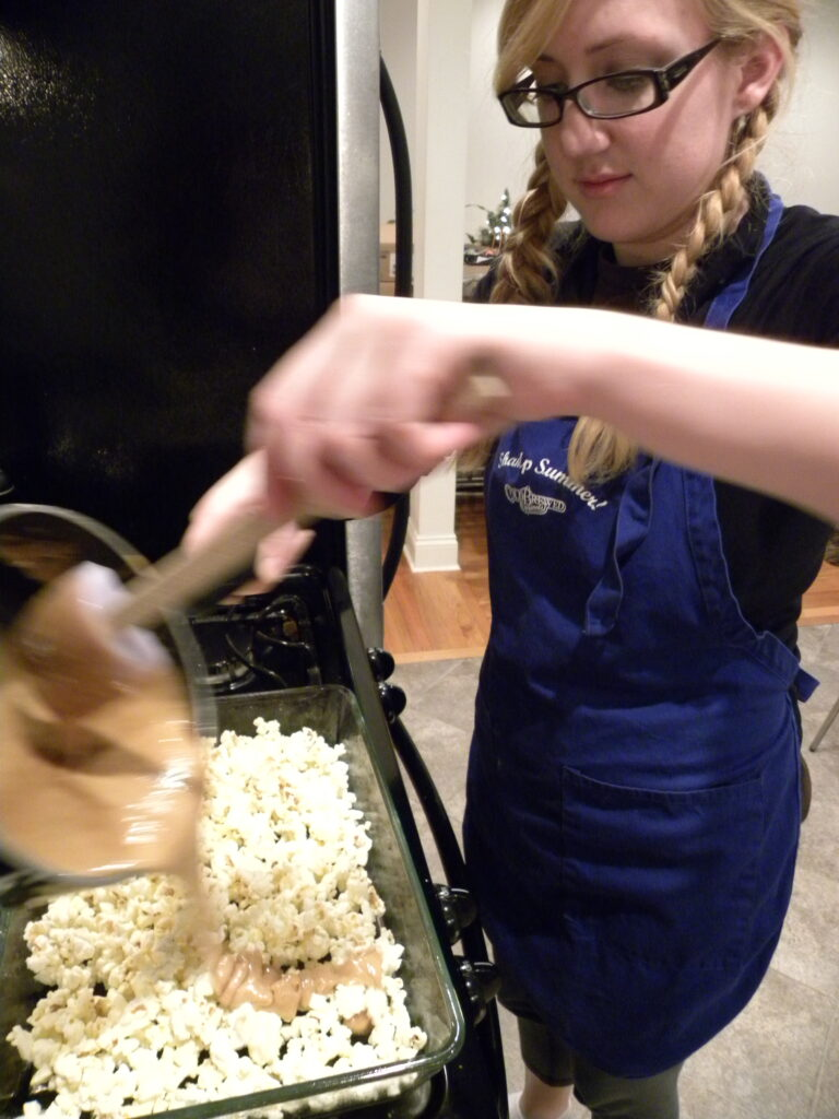 pouring over popcorn