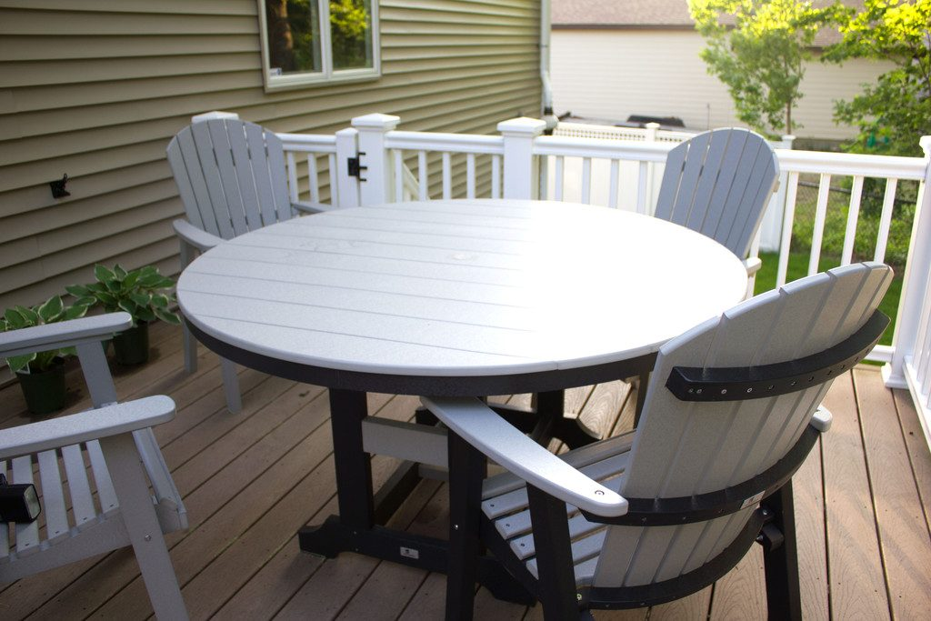 New deck furniture featuring a round table and chairs