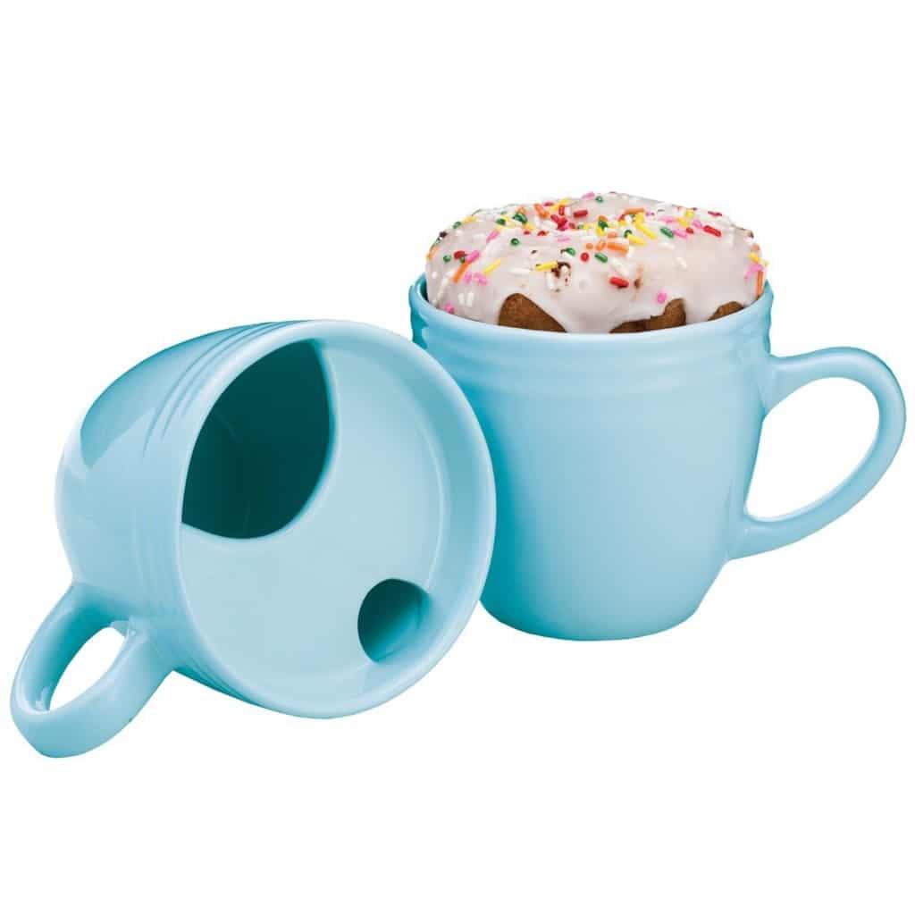 Donut warming coffee mug with donut sitting on top